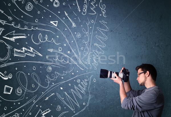 Fotógrafo menino tiroteio enérgico Foto stock © ra2studio