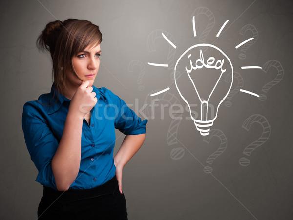 Jovem para cima luz idéia assinar bastante Foto stock © ra2studio