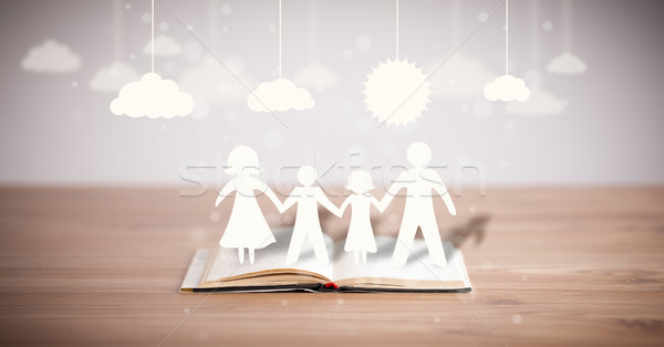 Cartone famiglia libro simbolo unità Foto d'archivio © ra2studio
