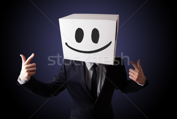 Empresario caja de cartón cabeza pie cara sonriente Foto stock © ra2studio