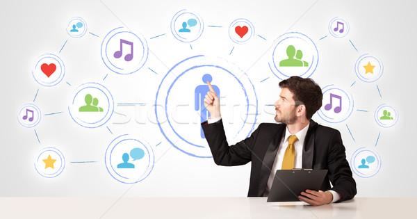 Iş adamı sosyal medya bağlantı işadamı oturma beyaz Stok fotoğraf © ra2studio