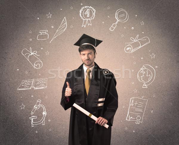 Happy graduate teenager with hand drawn school icons Stock photo © ra2studio