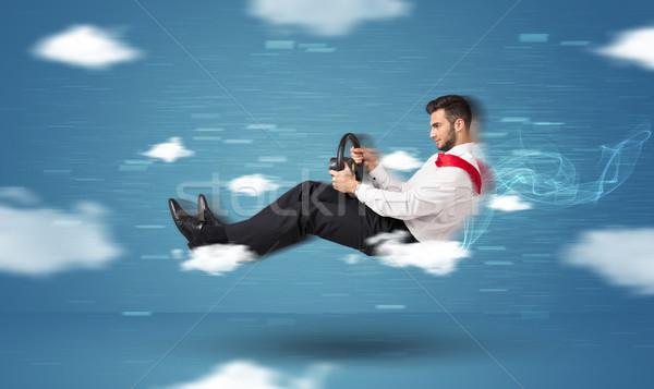 Drôle jeune homme conduite nuages bleu route Photo stock © ra2studio