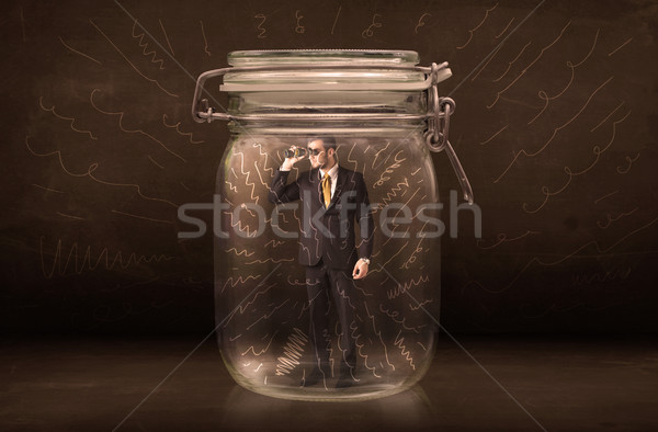 Businessman inside a jar with powerful hand drawn lines concept Stock photo © ra2studio