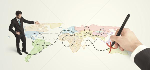 Empresário olhando mapa rota mão Foto stock © ra2studio