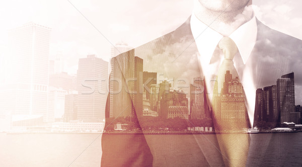 Zakenman permanente stadsgezicht warm licht business Stockfoto © ra2studio