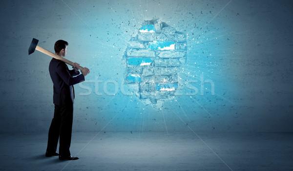 Business man hitting brick wall with huge hammer Stock photo © ra2studio