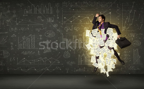 Handsome businessman jumping with paper document cloud Stock photo © ra2studio