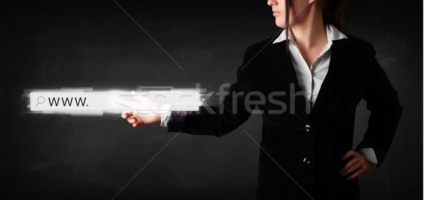 Young businesswoman touching web browser address bar with www si Stock photo © ra2studio