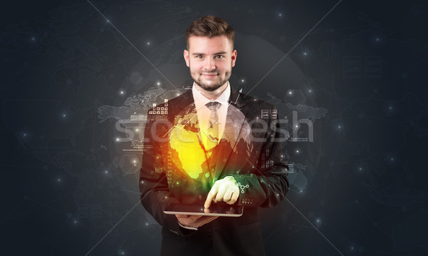 Spectacled businessman with tablet and apps above Stock photo © ra2studio