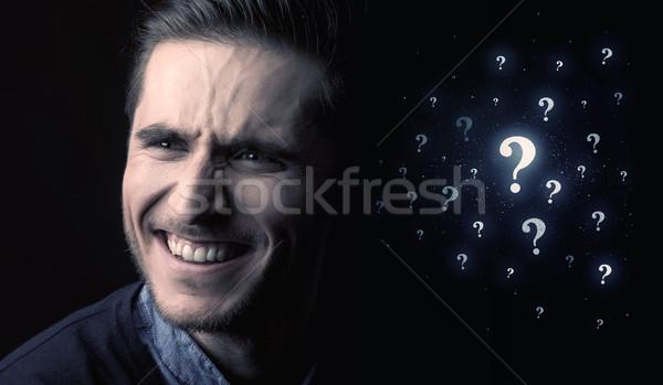 man with many question mark near him Stock photo © ra2studio