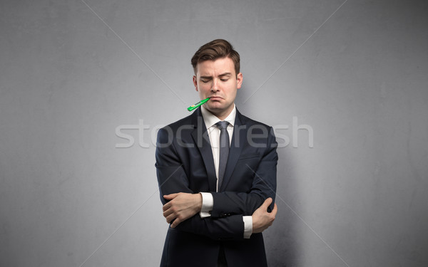 Businessman with thermometer and copy space Stock photo © ra2studio