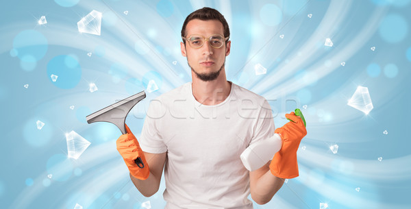 Blue diamond graphic and cleaning boy Stock photo © ra2studio