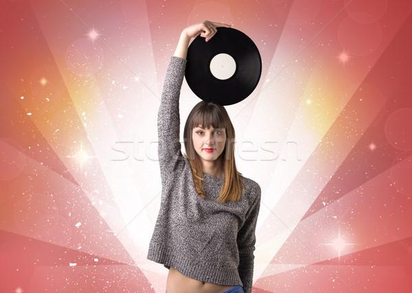 Lady holding vinyl record Stock photo © ra2studio