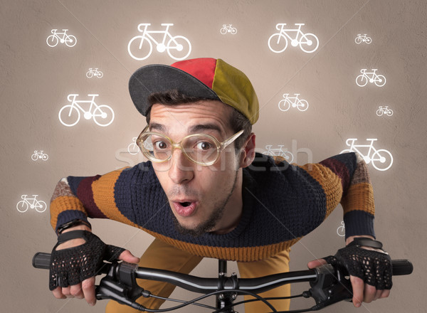 Lunatic cyclist with bike on the background Stock photo © ra2studio