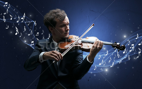 Lonely composer playing on violin Stock photo © ra2studio