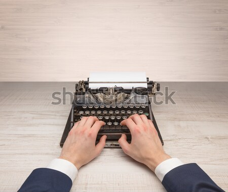First person perspectve hand writing on an oldschool typewriter Stock photo © ra2studio