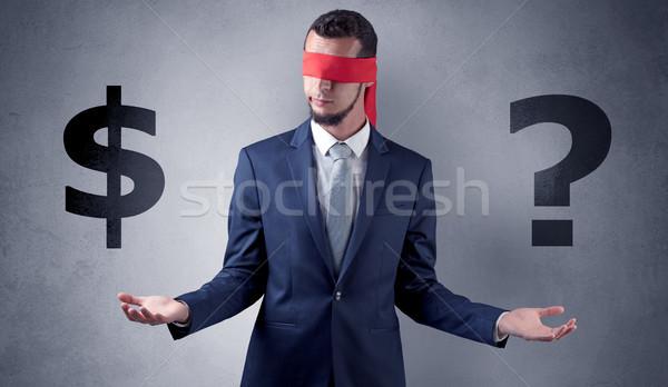 Man with ribbon on his eye holding dollar signs Stock photo © ra2studio