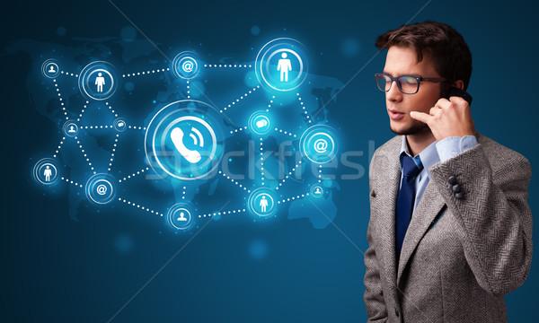 Fiatal srác készít telefonbeszélgetés közösségi háló ikonok áll Stock fotó © ra2studio