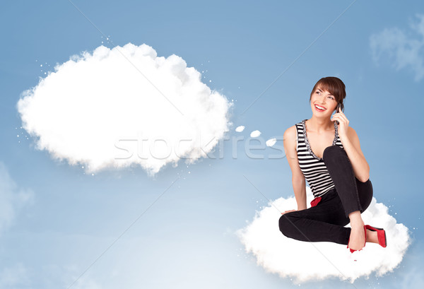 Pretty young girl sitting on cloud and thinking of abstract speech bubble Stock photo © ra2studio