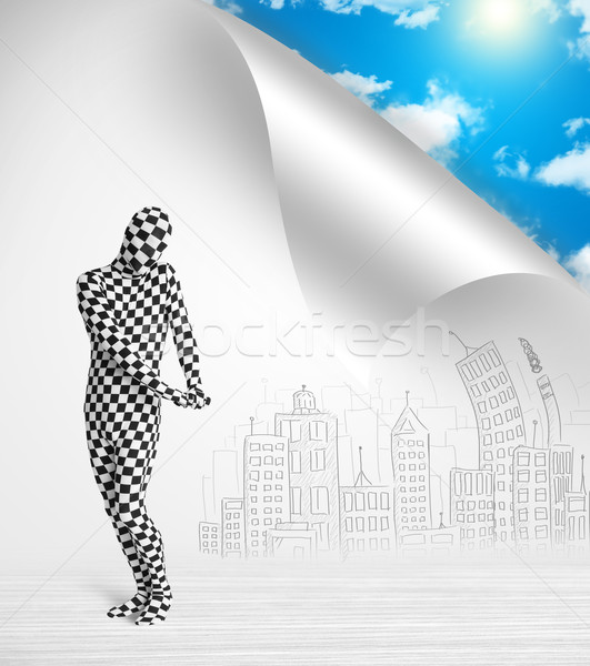 Man in body suit escaping from city to nature concept Stock photo © ra2studio