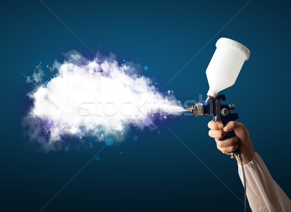Painter with airbrush gun and white magical smoke  Stock photo © ra2studio