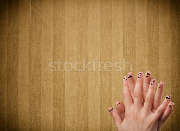 Happy finger smileys with vintage stripe wallpaper background Stock photo © ra2studio