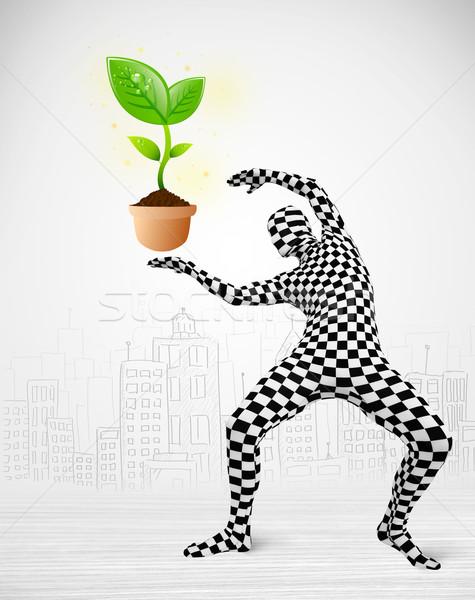 man in full body suit with eco plant Stock photo © ra2studio