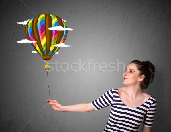 Woman holding a balloon drawing Stock photo © ra2studio