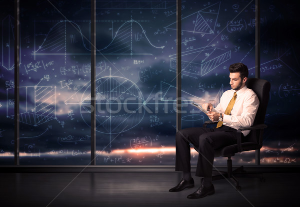 üzletember tart tabletta iroda szoba grafikon Stock fotó © ra2studio
