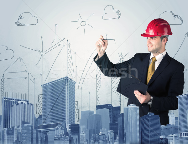Young worker drawing a city sight Stock photo © ra2studio