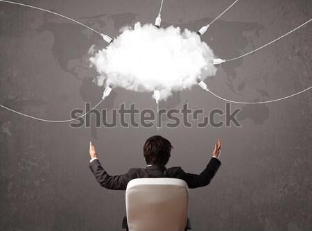 Młody człowiek patrząc Chmura transfer świat usługi Zdjęcia stock © ra2studio