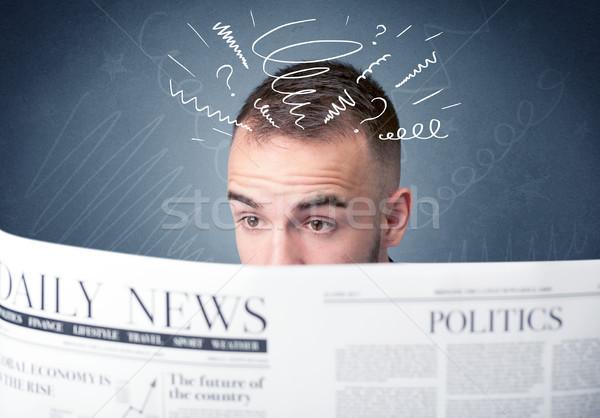 Businessman reading newspaper in front Stock photo © ra2studio