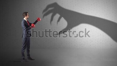 üzletember harcol ijesztő kéz árnyék pici Stock fotó © ra2studio