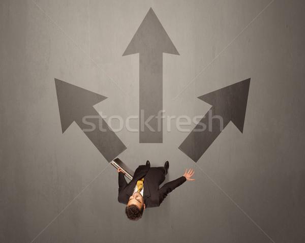 üzletember készít döntés fiatal barna nyilak Stock fotó © ra2studio