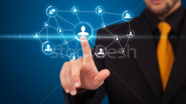 Businessman pressing modern social type of icons Stock photo © ra2studio
