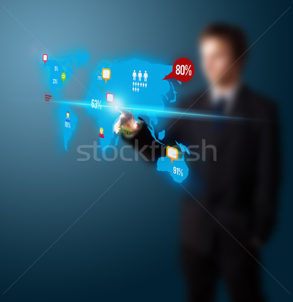 Businessman pressing social media button on digital map Stock photo © ra2studio