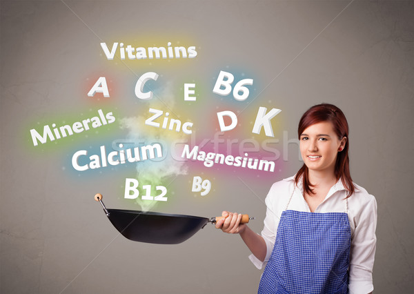 Young woman cooking vitamins and minerals Stock photo © ra2studio