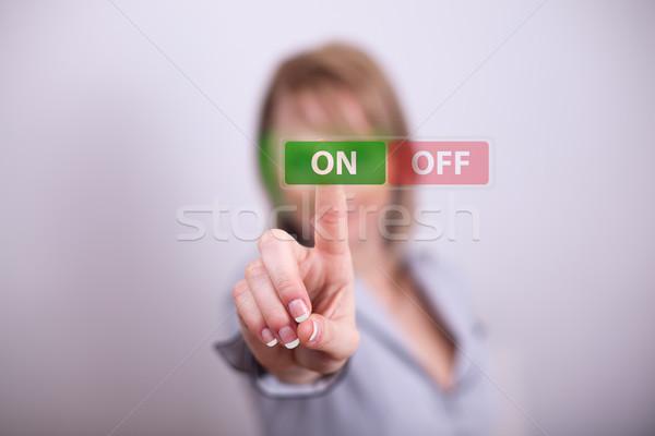 Woman pressing on off button Stock photo © ra2studio