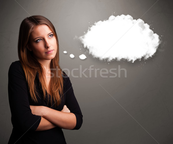 Pretty young lady thinking about cloud speech or thought bubble Stock photo © ra2studio