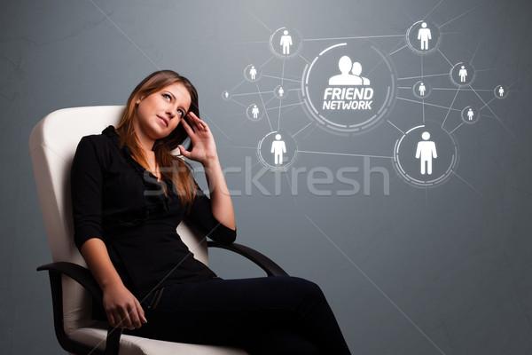 çekici kız bakıyor modern sosyal ağ çekici genç kız Stok fotoğraf © ra2studio