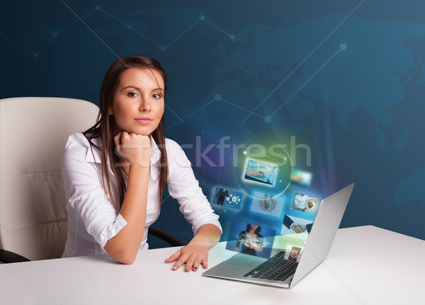 красивая девушка сидят столе смотрят фото галерея Сток-фото © ra2studio