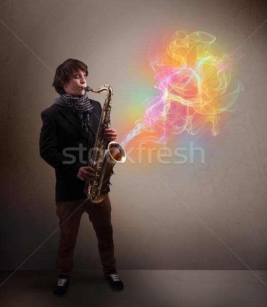 Vonzó zenész játszik szaxofon színes absztrakt Stock fotó © ra2studio