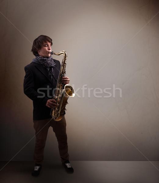 Młodych muzyk gry saksofon przystojny muzyki Zdjęcia stock © ra2studio