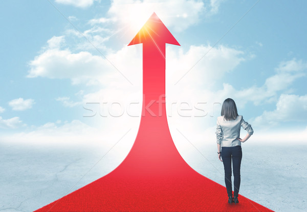 businesswoman standing on a red arrow Stock photo © ra2studio