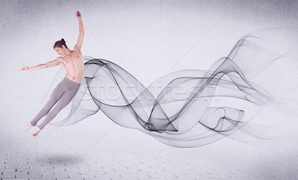 Nowoczesne baletnica streszczenie obracać człowiek Zdjęcia stock © ra2studio