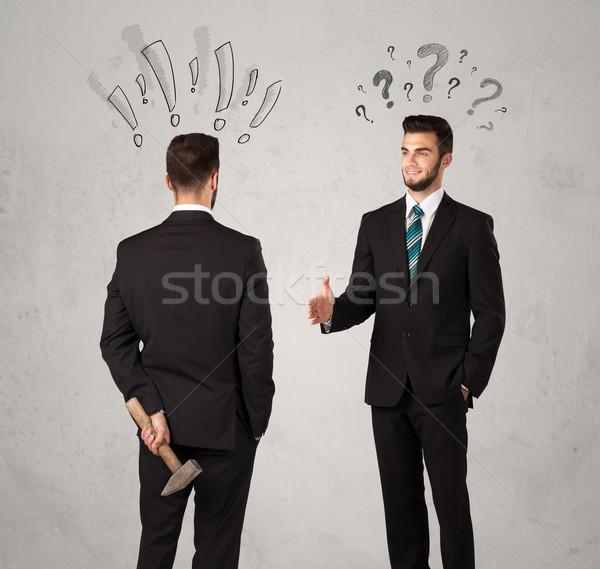 Ruthless business handshake Stock photo © ra2studio