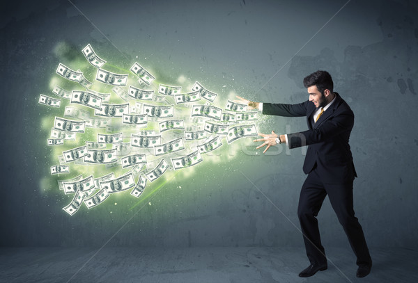 Business person throwing a lot of dollar bills concept Stock photo © ra2studio