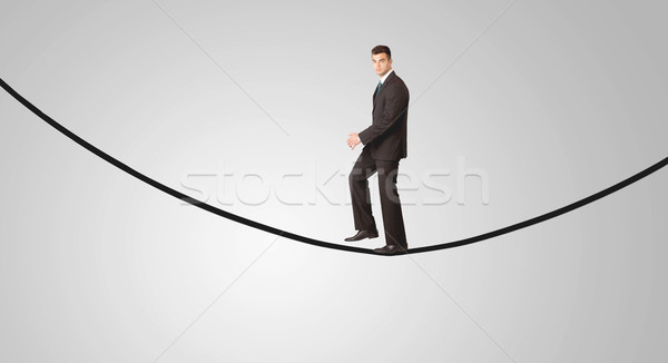 Feliz empresário caminhada corda sorridente vendedor Foto stock © ra2studio