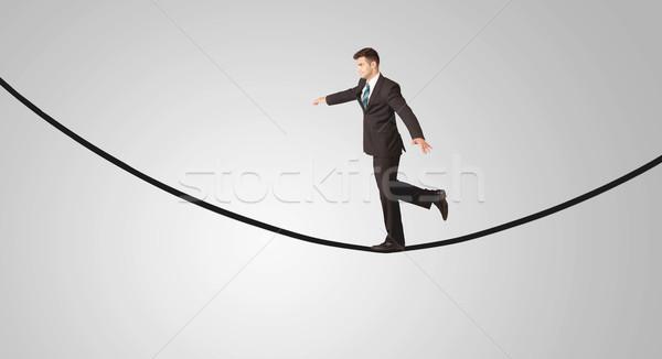 Gelukkig zakenman lopen touw glimlachend verkoper Stockfoto © ra2studio